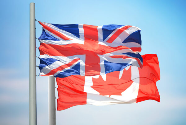 The UK and Canadian flags flying together.
